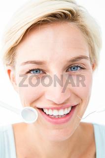 Pretty woman holding dental tools