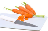 Carrot and knife on cutting board isolated on white