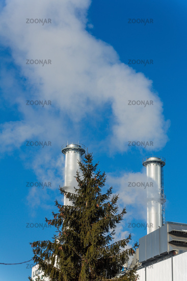 Industrial chimney with tree