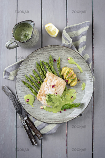 coal fish fillet with green asparagus