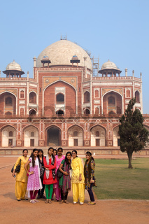 Group of indian girls standing infront of Humayun's Tomb, Delhi, India