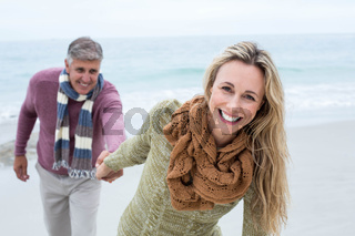 Happy woman pulling her partner towards her