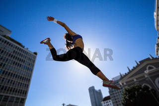 Athletic woman jumping in the air