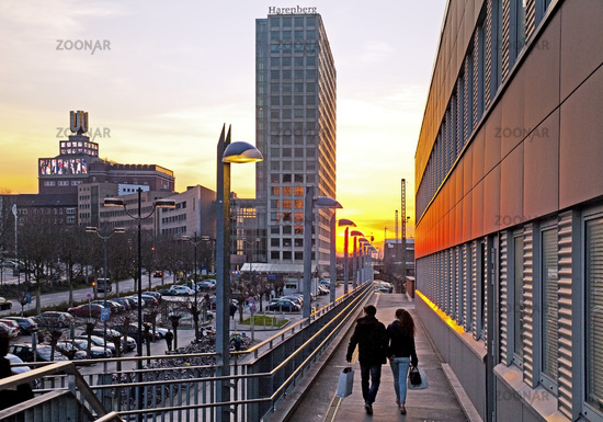 A young couple at the main station goes on the Harenberg City Center, Dortmund, Ruhr Area, Germany