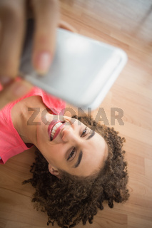 Young creative businesswoman taking a selfie