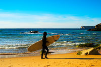 Surfer on the beach, silhouette