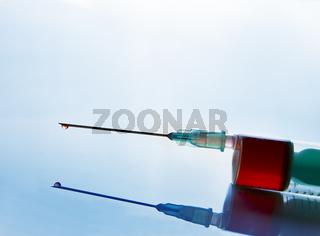 Syringe with blood sampling front tilt view blue