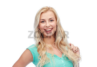 smiling young woman holding her strand of hair