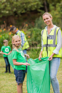 Happy family collecting rubbish