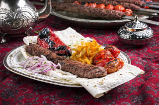 grilled adana kebab with vegetables