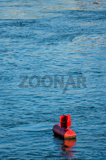 red buoy water surface