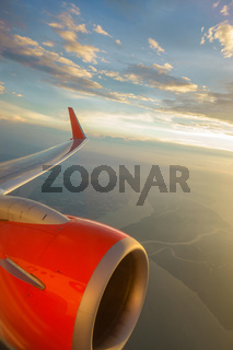 Airliner in flight at sunset
