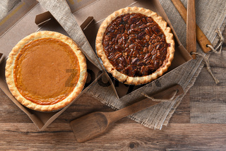 Pumpkin and Pecan Pies in Bakery Boxes