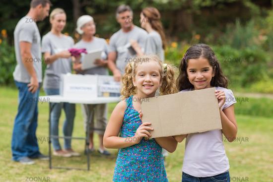 Happy children holding blank