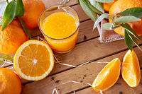 Orange juice on a wooden table top