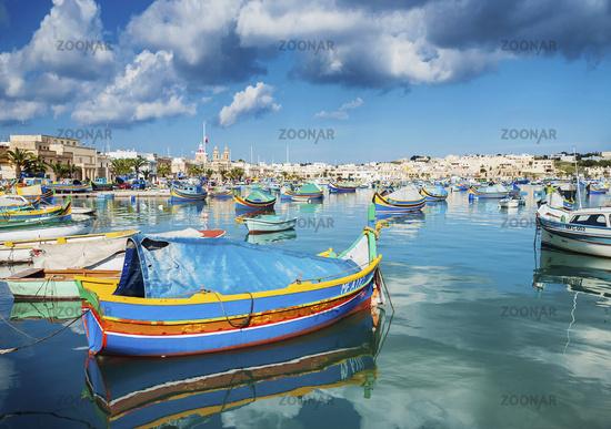 marsaxlokk harbour and traditional mediterranean fishing boats in malta