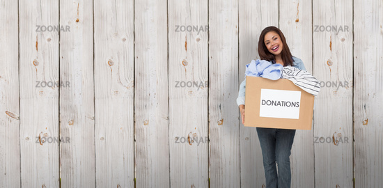 Composite image of portrait of a young woman with clothes donation