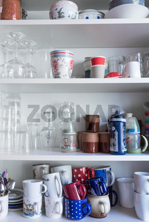 cupboard with kitchen ware