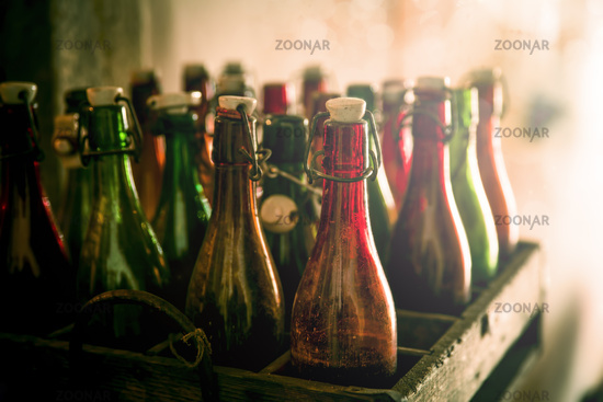 Old beer bottles in a wooden crate