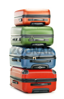 Luggage consisting of four polycarbonate suitcases isolated on white