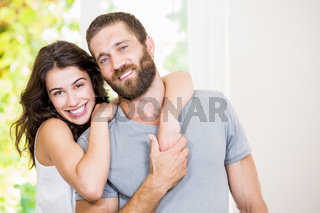 Portrait of young couple embracing