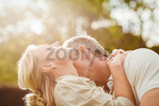 Husband kissing wife on the neck