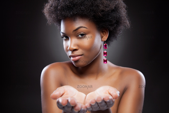 Attractive black beauty reaching out hands