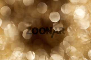 Goldenes Bokeh mit dunkler werdendem Zentrum