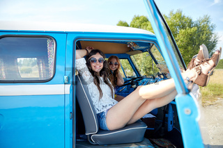 smiling young hippie women resting minivan car