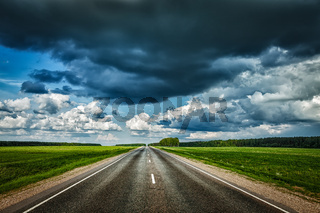 Road and stormy sky