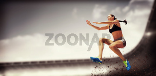 Composite image of sporty woman jumping