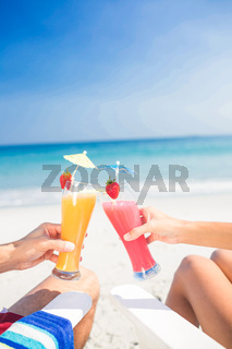 Couple toasting together at the beach