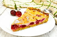 Pie cherry with sour cream in white plate on board