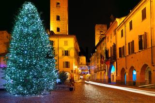Christmas tree on central plaza. Alba, Italy.