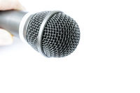 Microphone with holding arm isolated on white back