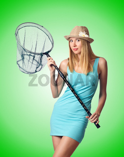 Attractive woman in butterfly catch