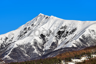 Mountains peak covered with snow.