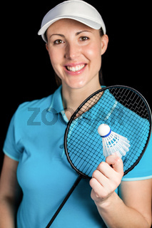 Badminton player holding badminton racket and shuttlecock