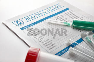 Blood test report with vials urine container and syringe