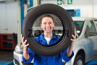 Mechanic looking through tire wheel