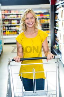 Smiling woman pushing cart