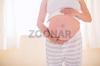 Pregnant woman holding her bump