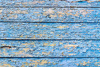 Old board with peeling blue paint