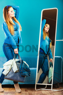 Fashion woman wearing blue denim in front of mirror