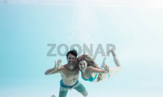 Smiling couple under water