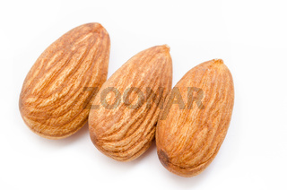 Whole almonds on a white background