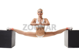Erotic sport. Sexy girl doing gymnastic split
