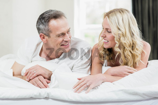 Cute couple lying on their bed