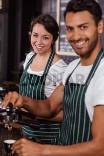 Smiling baristas working