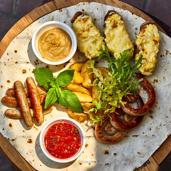 Grilled sausages and vegetables  in rustic style.